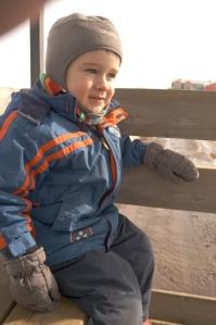 Cute boy on wagon