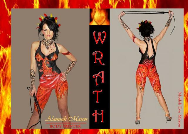 Woman's body painted in fire costume