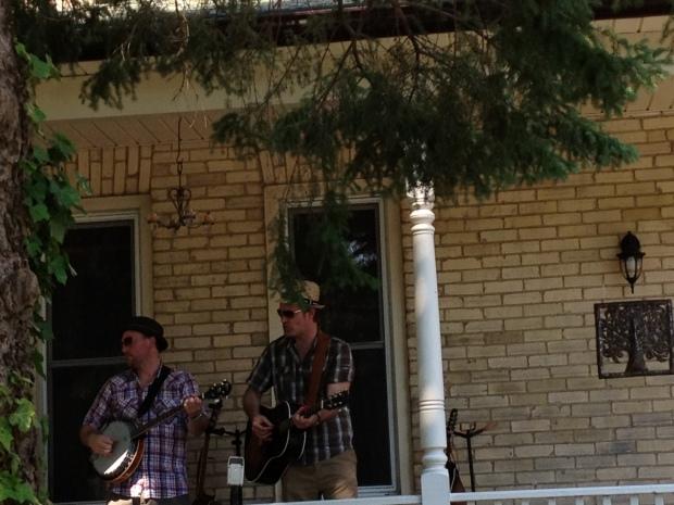 Men playing music on porch