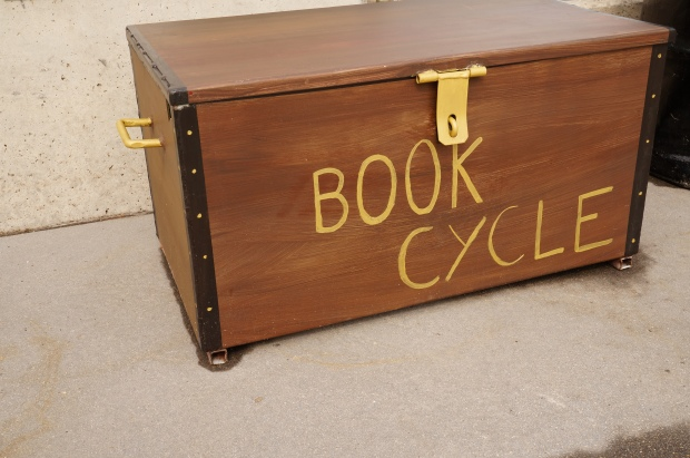 Metal trunk with books