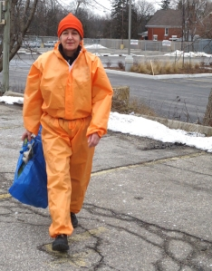 woman in orange jumpsuit with garbage bag