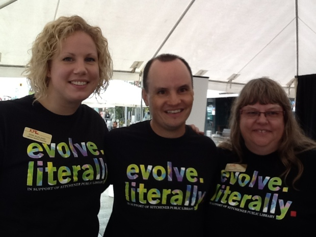 Two women and one man in evolve literally tshirts