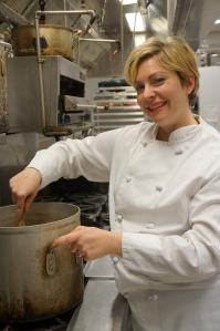 Woman chef in professional kitchen
