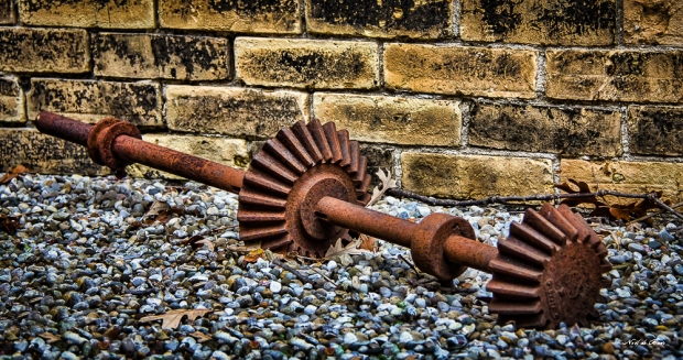 Rusted gear on gravel