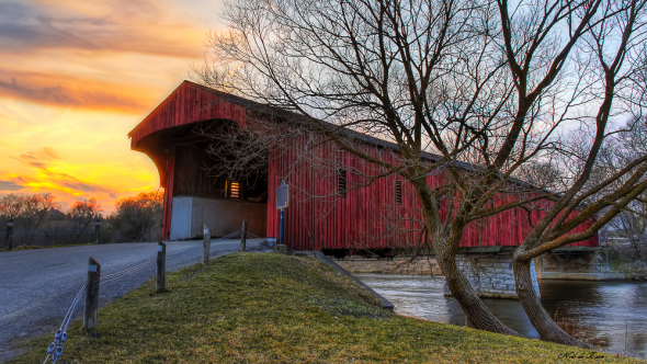 red covered bridge at sunset