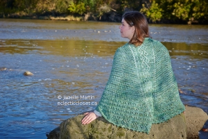 Woman in green shawl at river