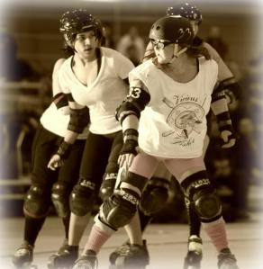 two women playing roller derby