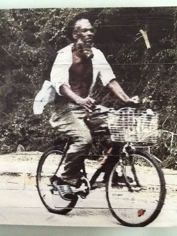 Photo of man riding bike