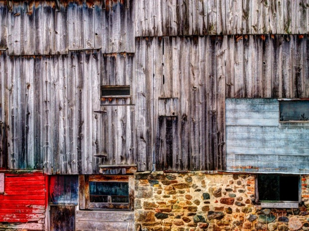 old barn with stone wall, red colour
