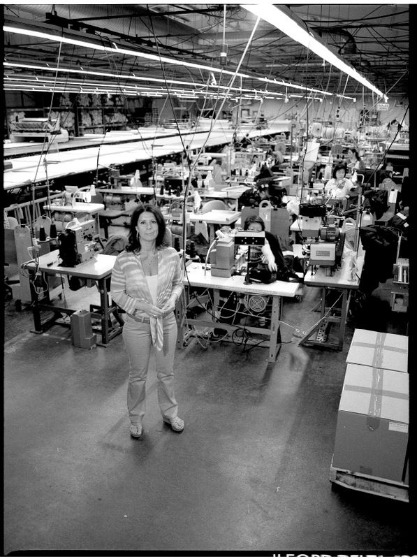 Black and white - woman standing in garment factory