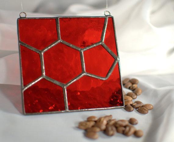 Glass art representation of caffeine molecular