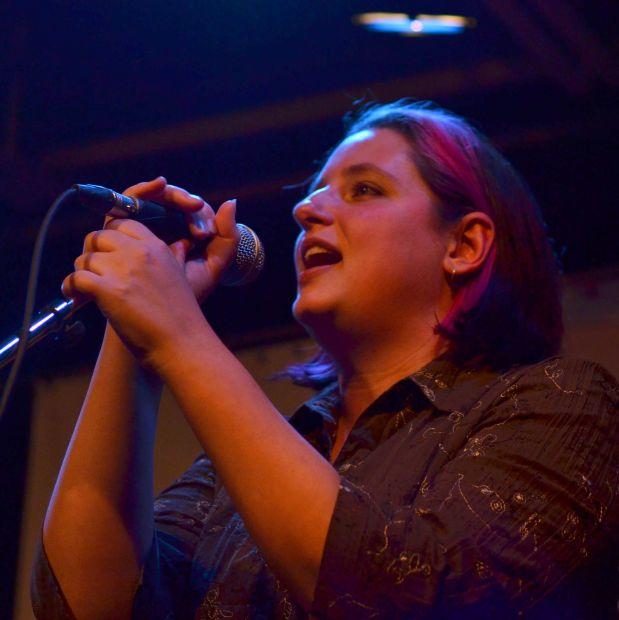 Woman singing into mic