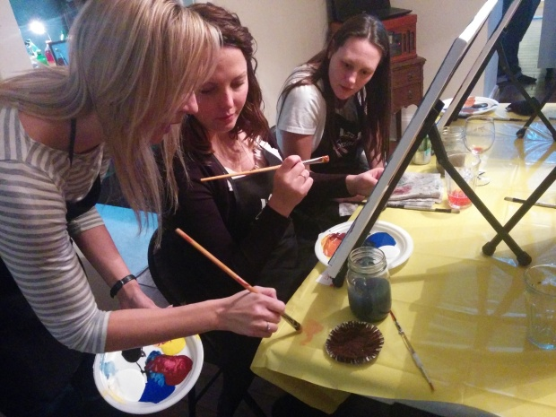 Woman teaching others how to paint