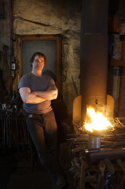 Man standing in blacksmith forge