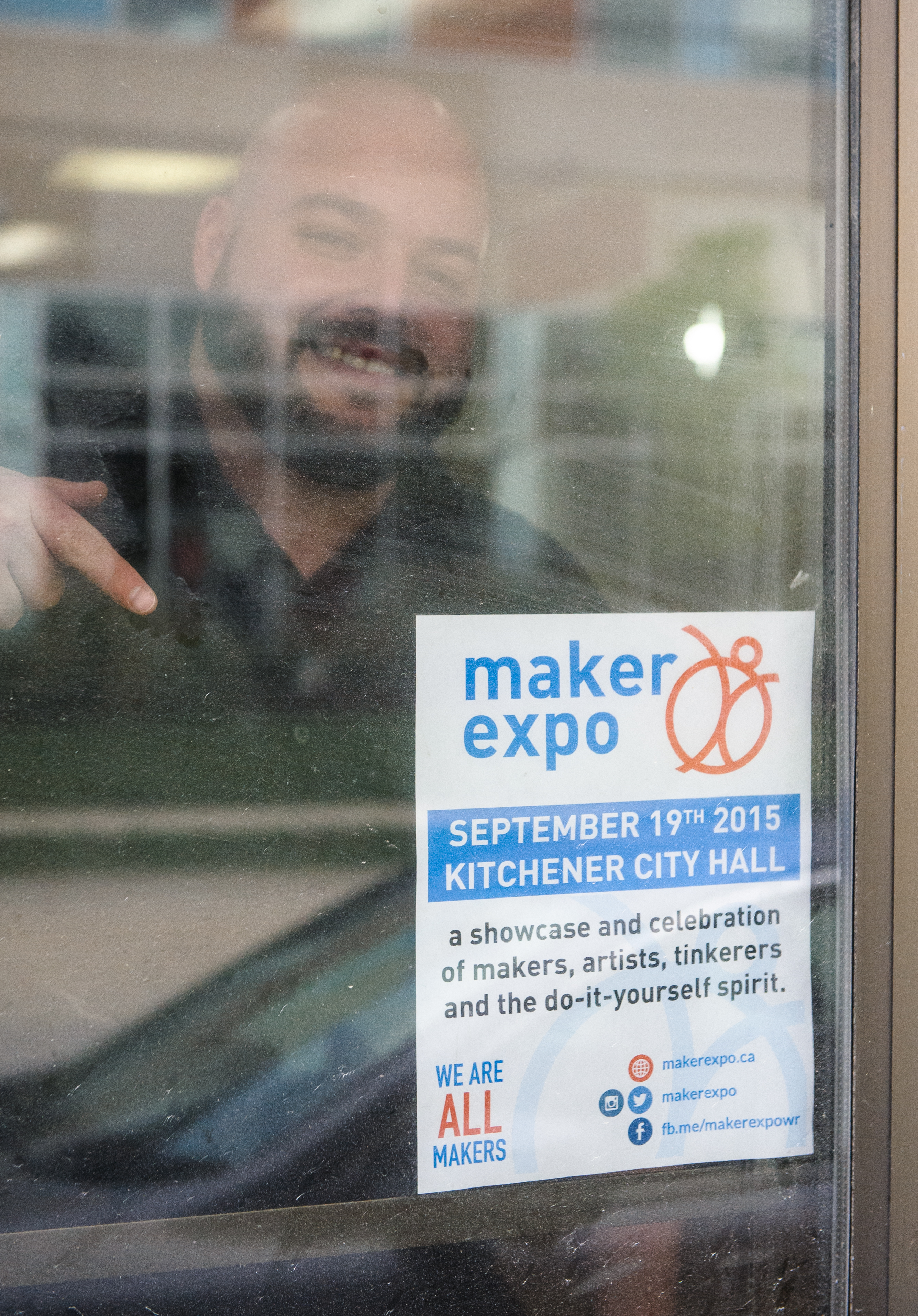 Kitchener red leather booth man behind window pointing at poster solutioingenieria Choice Image