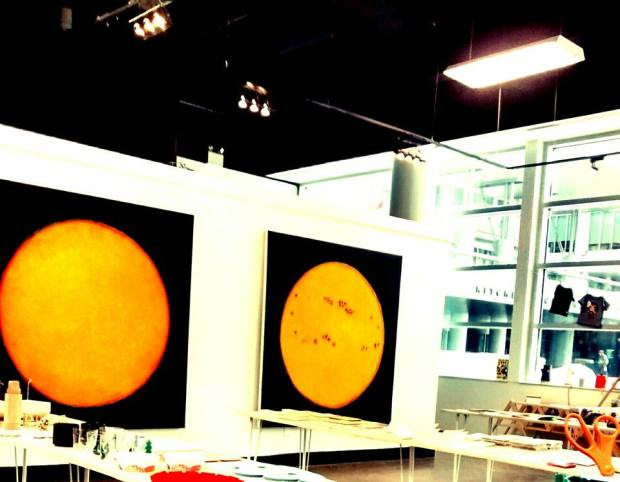 Gallery with two large sun paintings, photo by Jessica Neilsen
