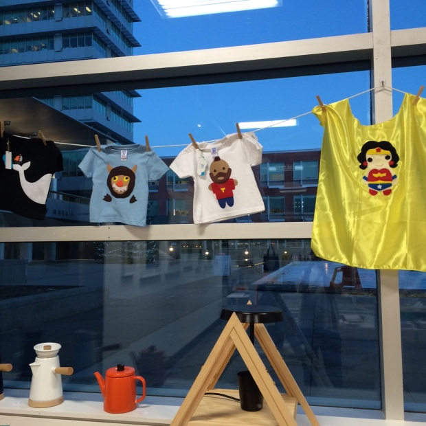 Kid t-shirts hanging in a window