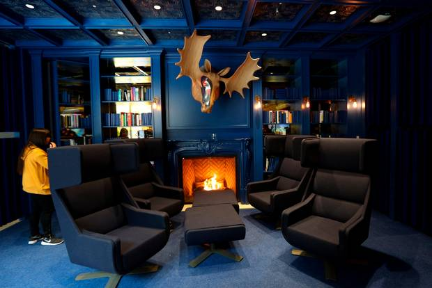 blue room with moose head and cozy chairs