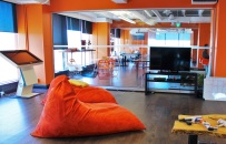 orange bean bag chair in cool work tech company work space