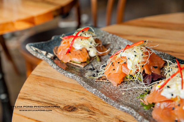 salmon appetizer on grey plate